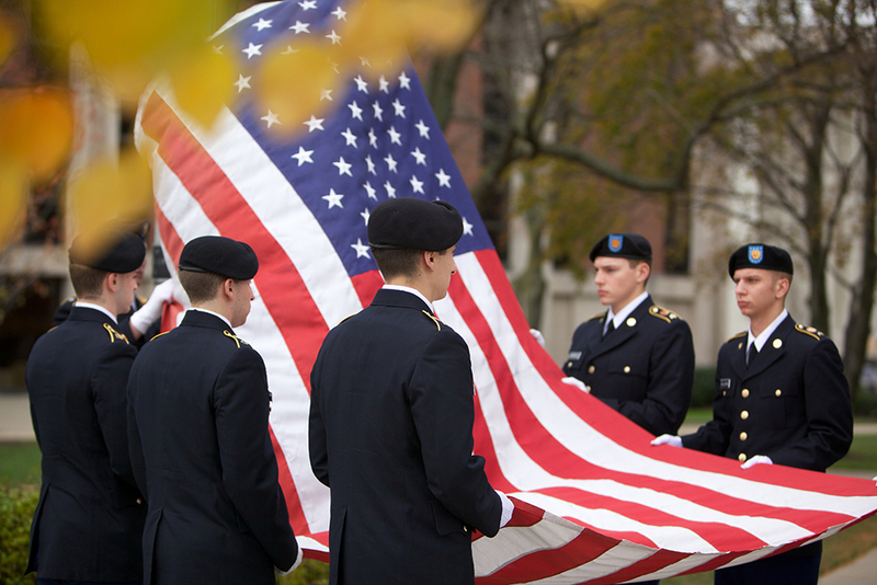 Members of the ROTC program hold the flag before it is raised during Monday's Veteran's Day Ceremony.