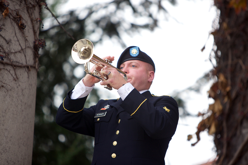 Philip Kovach, a member of the 198th Army Band Buglers, plays taps during the ceremonies on Veteran's Day on Monday.