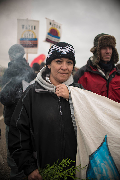 Dani, a woman from Montana, peacefully protests at Standing Rock.